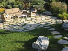 Outdoor Landscaping Flagstone | This irregular flagstone patio is used for relaxing and entertaining ...