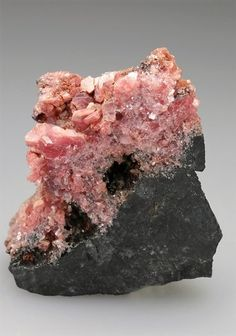 Ephesite is an uncommon member of the Mica Group named after the Greek for an ancient city in Turkey. The specimen we have from the Postmasburg Manganese Field, South Africa.  Crystal Classics Minerals
