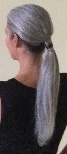 Just because a woman has grey hair, doesn't mean she has to wear it short.  This is really pretty, and feminine.