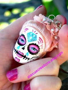 This is a listing for a custom made day of the dead doll keychain. It will include one custom made/hand painted doll head attached to a keychain for all of your sugar skull needs! Just convo me with your preference for doll hair color/ paint design/ and anything else you may have mind for your keychain and I will custom make you one to your liking! Check out our instagram and Facebook for more custom sugar skull examples!  https://www.instagram.com/starosecreations…