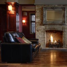 The fireplace with antique mirror is a great combo... this room has a great feel for a basement lounge/ bar
