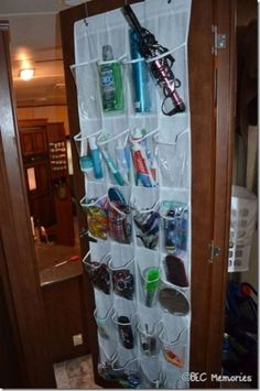 Many different organization ideas we use in our trailer for full-time RV travel this summer! Would be great on back of bathroom door in the camper! Travel Trailer Organization, Trailer Storage, Camper Storage, Rv Organization, Trailer Diy, Organizing Ideas, Astuces Camping-car, Rv Campers, Camper Van