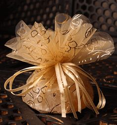 Decorative tulle tied with ribbon and filled with bulk candy or other goodies...inexpensive favors.