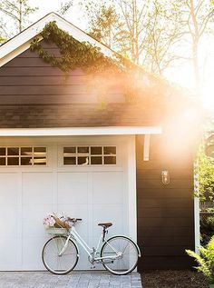 Amping up her curb appeal, she added little stone pavers and built a garage that matches the sleek charcoal gray and white of the main house.