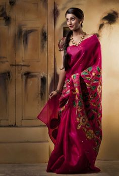 Ruby pink organza saree with hand painted kalamkari appliquéd with tiny mirrors