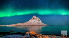 Aurora Borealis or Northern lights over Mt. Kirkjufell © Ragnar Th. Sigurdsson