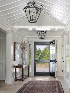 Traditional entry...love the large screen door.