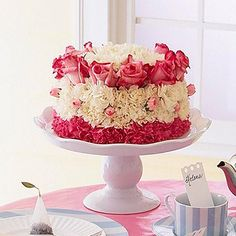 """""""Cake"""" Bouquet Centerpiece ~ Make a blooming """"cake"""" instead of the usual bouquet. Place florist's foam on a cake stand. Stick in carnations, mums, and roses in layered rings. The centerpiece will look good enough to eat!"""