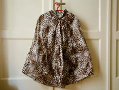 Hey, I found this really awesome Etsy listing at https://www.etsy.com/listing/159422606/leopard-raincoat-vintage-inspired-cape