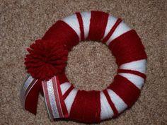 Mini Christmas Wreath. Made from a small Styrofoam wreath (flat back kind) yarn and ribbon.