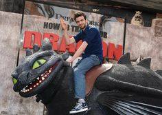 Jay Baruchel (voice of Hiccup) on a life-size Toothless