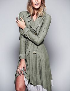 Love this ruffle trim trench coat