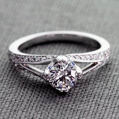 0.70 Carat Round Diamond, F, VS1, Ideal Cut, GIA Certified in an 14K White Gold Art Novo Engagement Ring.