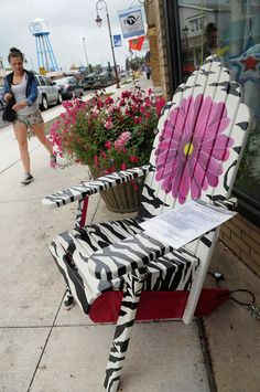 """Description of . """"Petals & Stripes"""", painted by by Donyal Eret, sits in downtown Linstrom in hopes of attracting new business to the communi..."""