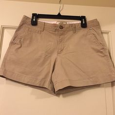 "NWOT Old Navy Khaki ""Perfect 5"" Shorts"", size 10 Brand new. never worn Old Navy 5"" khaki shorts. Button and zipper closure, front and back pockets. Size 10 Old Navy Shorts"