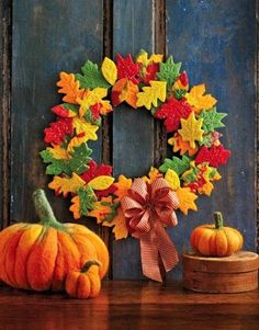 "Use ready to bake cookies to make the leaves, then ""glue"" to a wreath form with icing. Part of a collection of 12 fun fall crafts for kids!"