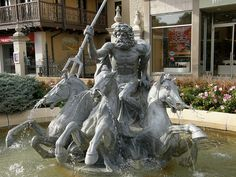 Fountain of Neptune on Country Club Plaza in Kansas City, MO.  Only Rome has more fountains! The Roman god of the sea and his three attributes, the trident, dolphin and seahorse, was bought at the cost of scrap metal and placed here. The fountain was originally from Bromsgrove Guild, Worcestershire, England, 1911.