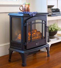 Our attractive stove heater has three clear sides so you can enjoy the realistic electric flames from every angle. Both useful and beautiful, this engaging d… Electric Wood Stove, Electric Stove Fireplace, Electric Fireplaces, Small Fireplace, Faux Fireplace, Stove Heater, Infrared Heater, Cooking Stove, Hearth