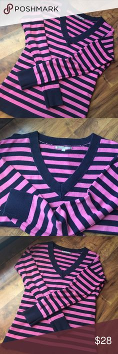 GAP V Neck Blue + Pink Striped Sweater The Gap Blue + Pink Striped V Neck Sweater. So comfortable + perfect with dark denim. Size XS but is roomy enough to fit most Smalls and some Mediums. GAP Sweaters V-Necks