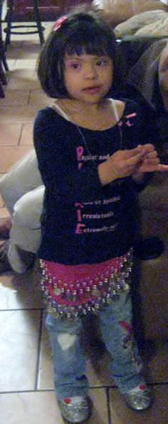 Many parents forget to stop and teach all the little things...This little girl loves the details...Mani/Pedi,Jewelry,Picking out cute things like this bellydancing skirt...Her favorite! :)