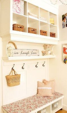 3. Kristin's mudroom maximizes wall space with a floor to ceiling storage unit full of cubbies and baskets. Best of all, it was built from inexpensive materials gussied up with trim and wainscot. Click through to her website to see more pictures from her DIY project.