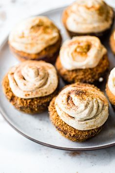 Flourless Peanut Butter Churro Cupcakes with Coconut Frosting! A gluten free cupcakes recipe that's easy to make, sweet, buttery, flakey, & paleo friendly.