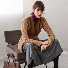 New neutral knitwear. Translating the iconic #MaxMara camel from coat to cardigan, with #FW17 shearling tone-on-tone touches.