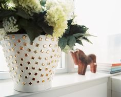 Eclectic Traditional Decor: A vase of hydrangeas on a windowsill.