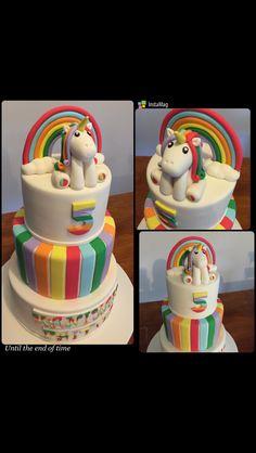 Rainbow theme cake with unicorn cake topper
