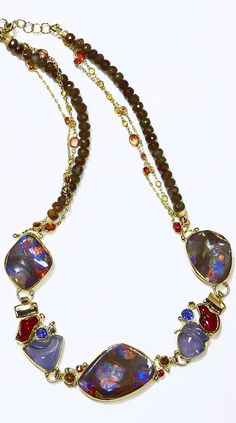 Jennifer Kalled, jewelry artist. Boulder opal & Mexican opal necklace with carved chalcedony, tanzanite and orange sapphire. 22k and 18k gold. Opals from Bill Kasso www.kalledjewelrystudio.com