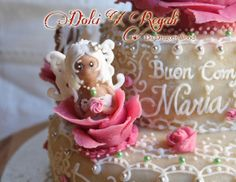 Rose fairy cake (not winx)  Orange curd sponge cake with marzipan (figures and flowers are almond paste - contain under 25% almond), royal icing decoration. Homemade natural food colour for the pink rose by beetroot.