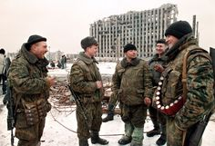 Chechnya. Grozny. February 1996. Russian soldiers joke in front of the destroyed presidential palace. Russian forces fought a brutal war in 1994-1996 to crush Chechen separatist rebels that ended in defeat for Moscow and killed at least 80,000 people, the vast majority of them civilians. Photograph: Alexander Nemenov/Getty