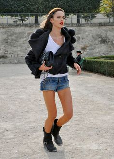 Besides her fab legs, I love this jacket- with the poms