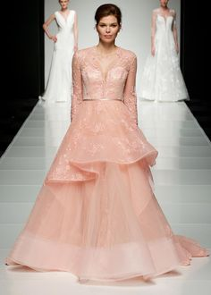 This amazing pink wedding dress by Savin London had the most stunning plunge neckline and beautiful lace adorning it. We would love to see a bride pull this look off with her girls in floral bridesmaids dresses – that would be a wedding picture that is definitely Pinterest-worthy.