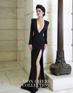 Soft silk crepe slim sheath with long sleeves, structured shoulder lines with architectural seaming throughout, front and back dramatic deep plunging V-necklines, plunging back secured with gold chain detail, high side slit. Custom colors are also available. Sizes: 0 – 16 Colors: Black, Ivory