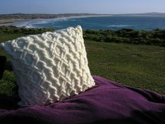Cabled knitted cushions