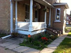 Railings restored to original to match front porch and side steps removed
