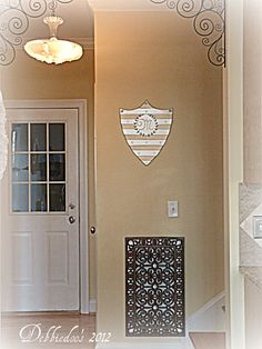 Repurposed door mat to cover ugly wall vent.  We have four--FOUR!--of these in the house we are buying.  How to cover or camouflage?  Need more ideas