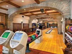 This bowling room/arcade is reached by an underground stone tunnel with candlelit sconces. How freaking cool is that?!