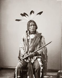 Yankton Sioux, known as Red Lodge with ceremonial pipe and feathered headdress, taken in 1872