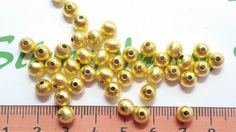 36 pcs per pack Round seamless Beads Brushed Gold-plated Finish Shape: Round Brushed Ball Size: Quantity: 36 pcs Color: bright Yellow Gold Gold Beads, Plating, Shapes, Color, Colour, Colors