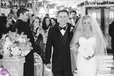 Beautiful bride walking down the aisle at Leonards Palazzo. Courtesy of Esvy Photography