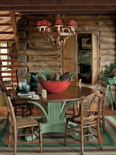 Love this table with the red bowl of pine cones