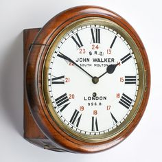 "JOHN WALKER, Brighton & South Coast, Railway clock, model 996 B, London, late 19th c. Mahogany, Marked ""John Walker 1. South Molton St., London 996. B."", 13"" x 13"" x 6"" - Price Estimate: $400 - $600"