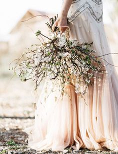 Be different and have a beautiful arrangement of twigs and wild flowers for your…