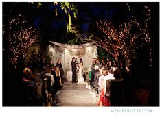 outdoor night ceremony... Have a light shining down the aisle so that everyone can see you right!