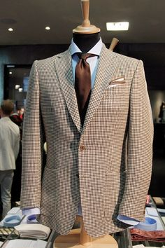 A stunning summer-tweed suit by Chester Barrie - I can't wait to see this in the shops.