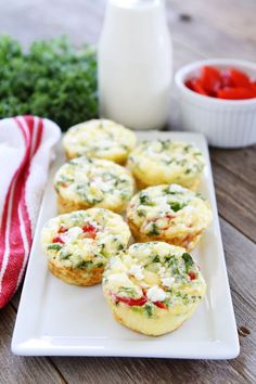 Egg Muffins with Kale, Roasted Red Peppers, and Feta Cheese Recipe on twopeasandtheirpod.com These easy egg muffins are perfect for a healthy breakfast on the go! They freeze well too!