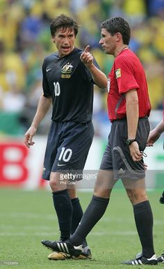 Harry Kewell of Australia has firm words Referee Markus Merk after the FIFA World Cup Germany 2006 Group F match between Brazil and Australia which Australia lost at the Stadium Munich on June 2006 in Munich, Germany. Soccer Pictures, Soccer Pics, Soccer Referee, Fifa World Cup, Brazil, Munich Germany, Australia, Football, Running