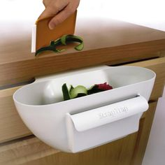 Scrap Trap is a handy scrap bowl that fits under the counter, over the drawer.